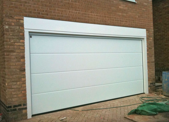 Fitting of new sectional garage door
