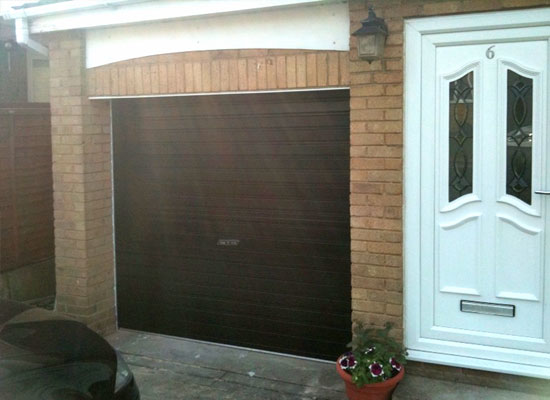 Manual black roller garage doors