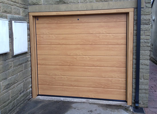 Hormann sectional garage door in Irish Oak